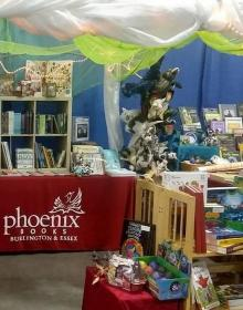 Part of the Phoenix Books booth with books, toys and games